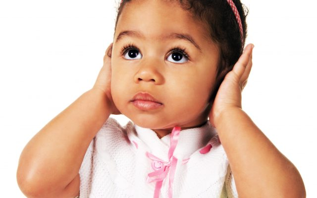 Cute little girl shutting dawn her ears, white background